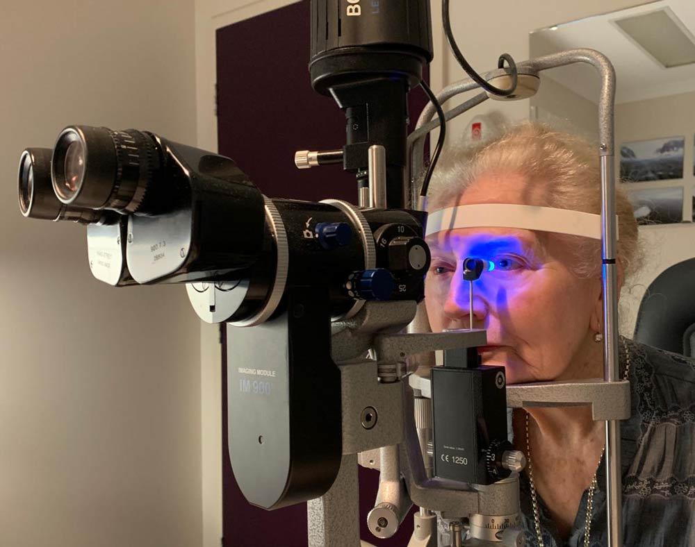 eye examination at slit lamp